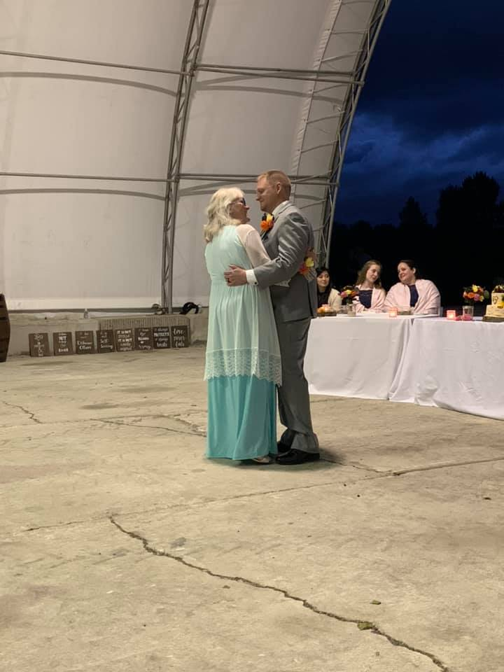 parents of the wedding couple dancing at the reception at pemberton farm weddings in snohomish wa