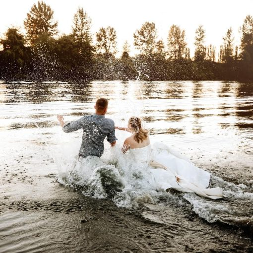 bride and groom running into the snohomish river at pemberton farm weddings in snohomish wa