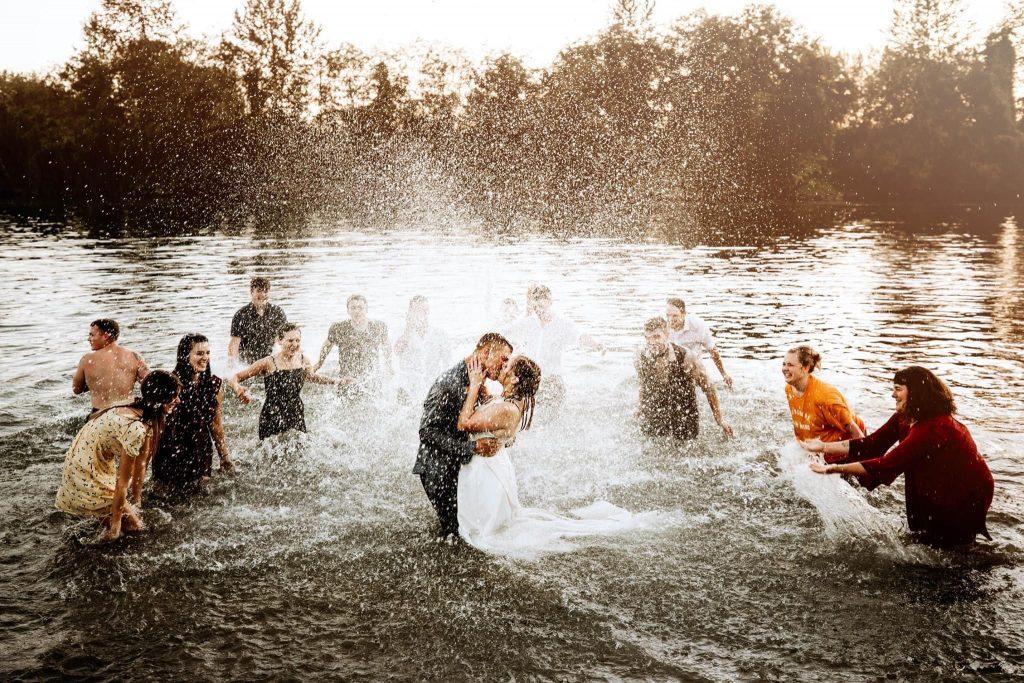 bridesmaids groomsmen bride and groom in snohomish river at pemberton farm weddings in snohomish wa